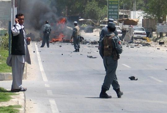 Afghan police secured the site of a car bomb blast in the eastern city of Jalalabad yesterday where a suicide bomber killed two soldiers and wounded four Afghan civilians.