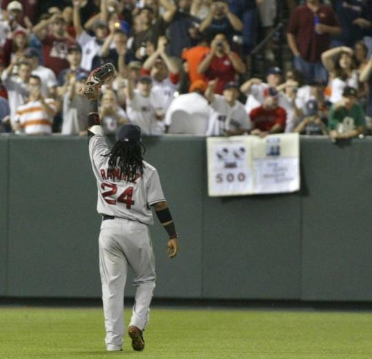 Manny Ramirez acknowledges cheers from the fans, many Sox boosters, after he hit No. 500 and went back out to left.
