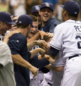 Gabe Gross's teammates make sure his walk-off homer doesn't go to his head after the Rays' victory.