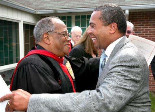 Governor Deval Patrick embraced the Rev. Peter J. Gomes before a special service held yesterday at The First Baptist Church of Plymouth. The church was celebrating the 40th anniversary of Gomes's ordination.