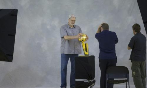 Los Angeles Lakers coach Phil Jackson poses with the championship trophy.