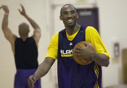 Lakers guard Kobe Bryant smiles during practice.