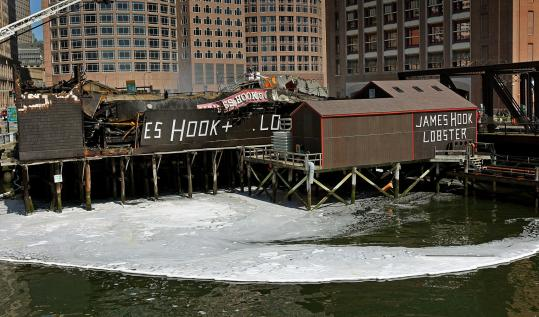 The cause of Friday's fire at James Hook & Co. lobster company in Boston has still not been determined.