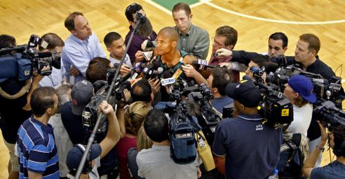Celtics guard Ray Allen is surrounded by the media as he takes questions after practice.