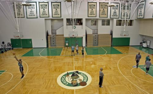 The Celtics will begin their quest for banner number No. 17 (replicas of the first sixteen are seen on the walls as they finish up practice Monday in Waltham).