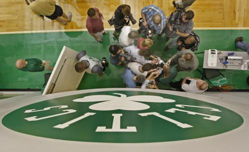 Celtics forward Kevin Garnett talks to reporters after practice.