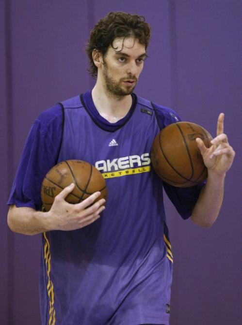 Pau Gasol gestures to a teammate during practice Monday.