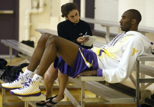 Kobe Bryant, right, is interviewed by the Boston Globe's Shira Springer.