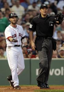 Dustin Pedroia pleads his case - successfully - to umpire Chad Fairchild that he was hit by a pitch in the third inning.