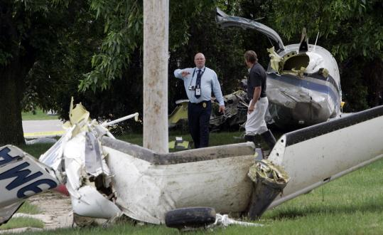 Investigators from the Federal Aviation Administration examined the wreckage of a small plane that crashed shortly after takeoff from the Iowa City Airport on Tuesday.