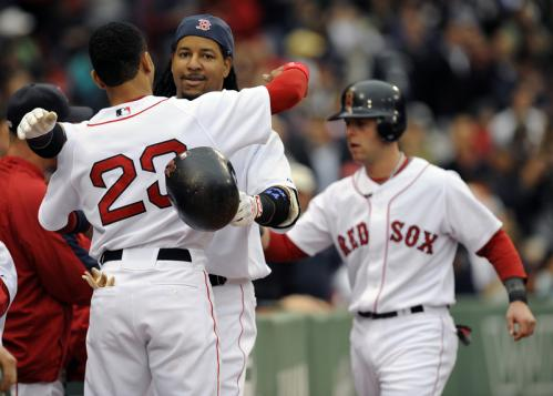 Red Sox DH Manny Ramirez celebrates his three-run homer with teammate Julio Lugo during the first inning.