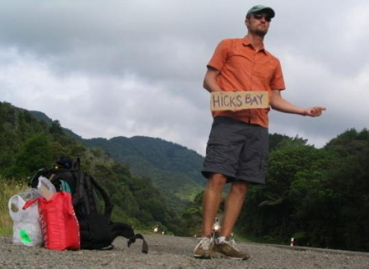 Hudson Doyle hitchhikes on the East Cape of North Island in New Zealand.