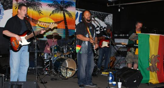 Members of the reggae band Noddaclu include (from left) Tom Guerriero, Tony Davies, and Kevin Morris.