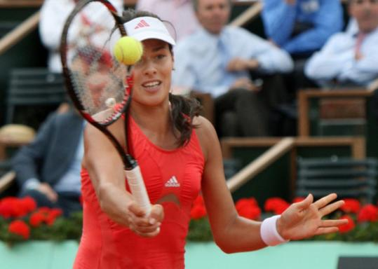 Ana Ivanovic returns a shot to Jelena Jankovic during her 6-4, 3-6, 6-4 semifinal victory in the French Open.