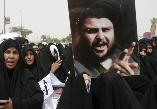 Iraqi women shouted slogans and held a poster of cleric Moqtada al-Sadr at a rally yesterday in Kufa during widespread Shi'ite protests against a security agreement with the United States.