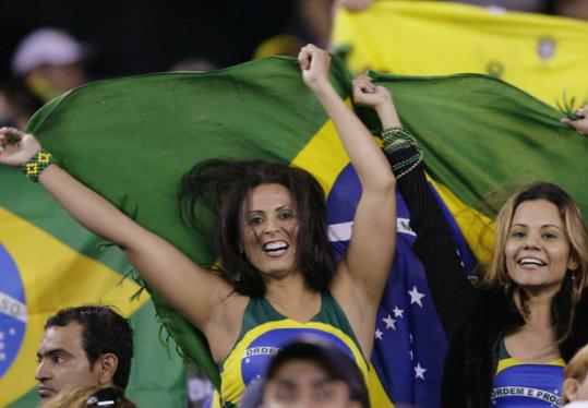Fans of Brazil exhibit their enthusiasm as their team takes the pitch for warm-ups prior to an exhibition against Venezuela.