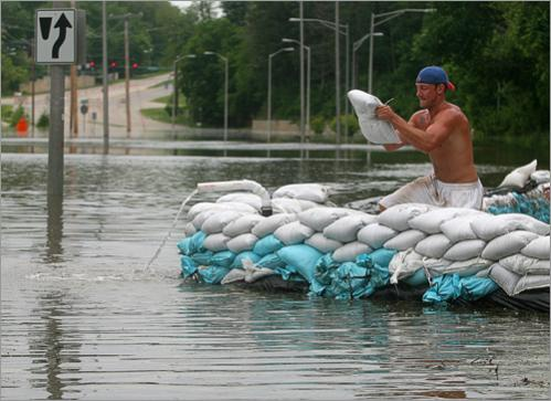 Ryan Strang of Iowa City works to strengthen a sandbag wall in front of The Cliff Apartments on Monday, June 9, 2008, in Iowa City, Iowa. Iowa Gov. Chet Culver said nearly a third of his state's 99 counties need federal help for flooded areas.