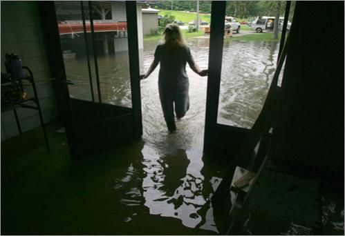 Beverly Chase walks into her flooded home in Iowa City, Iowa, Monday, June 9, 2008.