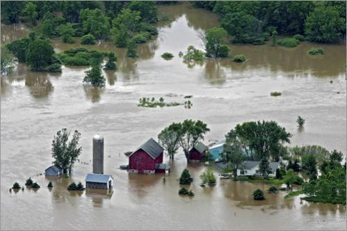 Flooding struck several Midwest states as heavy rain passed through the area. A Farmstead located West of Reedsburg, Wisconsin is mostly underwater Monday June 9, 2008. An earthen dam along a man-made lake gave way under severe flooding Monday, unleashing a powerful current that ripped several homes off their foundations and down the Wisconsin River.