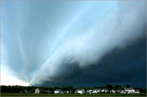 A cloud formation moves over Oconomowoc, Wis., Sunday, June 8, 2008, as the state contends with heavy rains, wind damage and areas of flooding. In Wisconsin, more than a dozen homes near the swollen Kickapoo River in La Farge were evacuated.