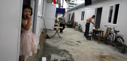 Earthquake survivors settled into new homes yesterday as a few start to move into the next phase of temporary shelters in Dujiangyan, Sichuan province, China. Tens of thousands of people have been left homeless and the death toll is over 69,000.