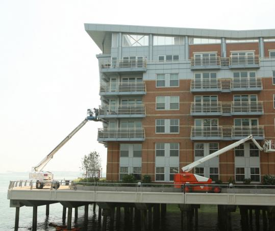 The Battery Wharf development will have 105 condominiums as well as a 150-room hotel.