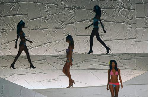 Models present creations by designer Salinas during the Rio Fashion Week Spring-Summer 2008-09 collection, at the Marina da Gloria on June 9, 2008 in Rio de Janeiro, Brazil.