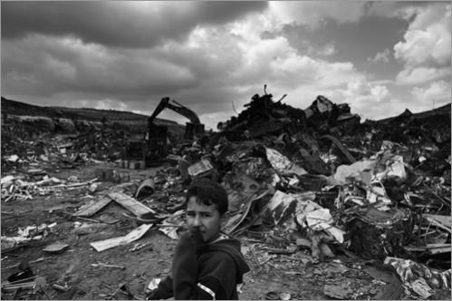 Palestinian Mohammed Khalil, 12, looks on while working in a scrap yard on the outskirts of Ramallah.