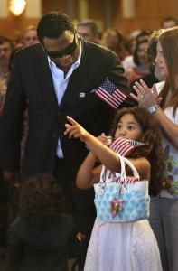 David Ortiz stood with his wife, Tiffany; daughter Alexandra, 7; and son, D'Angelo, 3, during the Red Sox star's citizenship ceremony held at the John F. Kennedy Library yesterday.