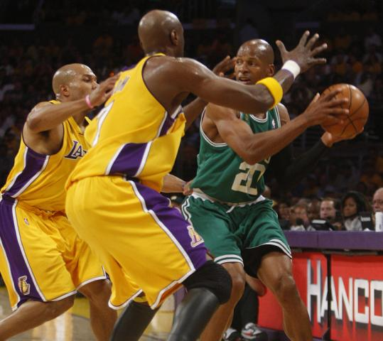 The Celtics' Ray Allen can't find a passing lane surrounded by Derek Fisher (left) and Lamar Odom in the first quarter.