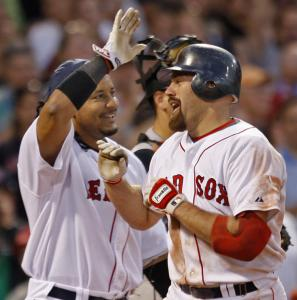 A pat on the head from Manny Ramírez is Kevin Youkilis's reward after his two-run homer in the seventh inning.
