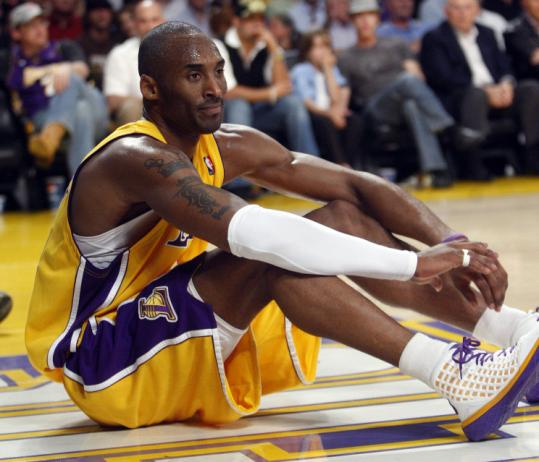 Kobe Bryant was down but not out after the loss. 'We let a huge opportunity slip away, so I'm upset, hurt,' he said.