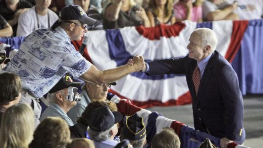 Senator John McCain of Arizona shook hands with a supporter yesterday during the question-and-answer portion of a town hall meeting in Pemberton, N.J.