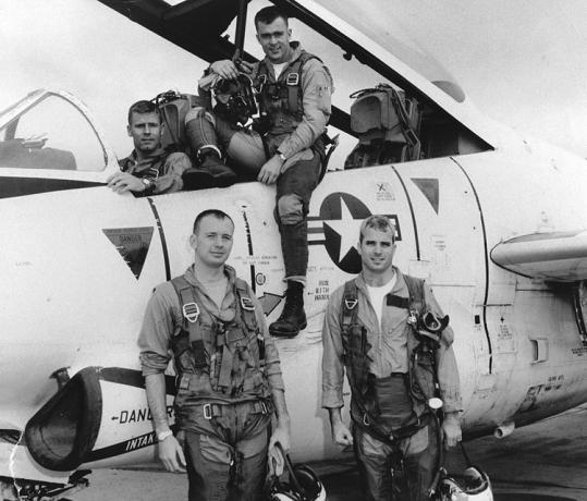 John McCain (bottom right) is seen with his squadron in 1965 in this undated photo. His 1974 essay addressed why some of his colleagues collaborated with the North Vietnamese.