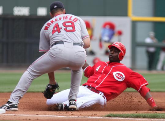 Tim Wakefield had to improvise as a third baseman in the second inning, tagging out Brandon Phillips.