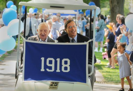 C. Yardley Chittick, 107, accompanied Donald Abbott during Phillips Academy's alumni parade in Andover yesterday.
