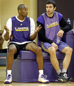 He's looked to for guidance, but the Lakers' Kobe Bryant doesn't seem to have an answer for Vladimir Radmanovic here.