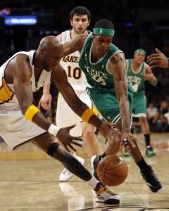 Rajon Rondo (1 point in four first-half minutes) battles the Lakers' Lamar Odom for a loose ball.