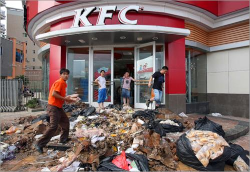 Kentucky Fried Chicken employees cleared out damaged items and spoiled food after floods in the town of Lechang in southern China's Guangdong province on June 15, 2008. Rains were expected to further pound southern China in the coming days, with rising river levels threatening towns in Jiangxi, Guangxi, and Guangdong provinces.