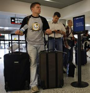 With many carriers now charging passengers who check their first bag, travelers are rethinking the way they pack.