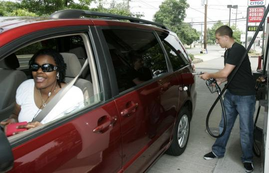 Gas station attendant Salim Sabbagh adds premium gasoline to customer Treena Bess's car in Paterson, N.J., yesterday.
