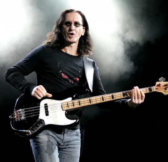 Rush (bassist Geddy Lee, above) offered up their hits in a show that was oddly similar to last year's show at the same venue.