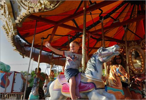 Four-year old Anthony Inferrera of Cohaset waves to his dad while riding the carousel on Friday at the Hanover Dare Carnival at Hanover Mall on June 13, 2008. Since 2004, the 25 inspectors with the Massachusetts Department of Public Safety have recorded 12 carnival accidents, but the record is improving. Only one accident has been reported this year.