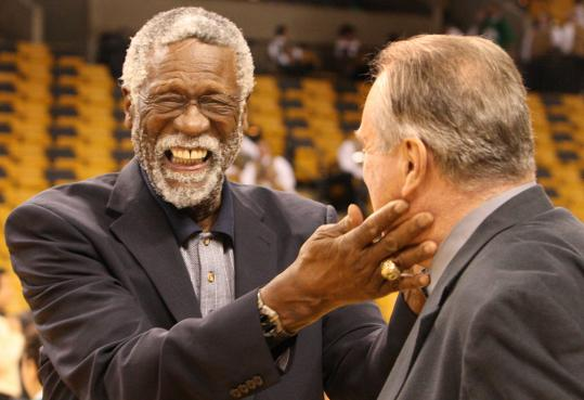 Bill Russell (left) and Tom Heinsohn touch base pregame, perhaps recalling Celtics Finals glory.