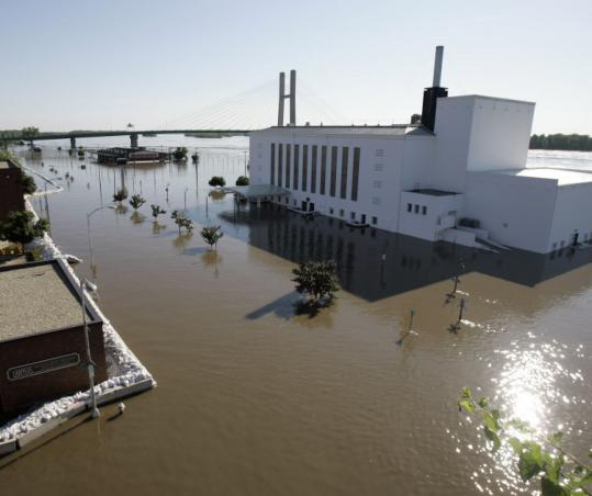 The Mississippi River overflowed its banks yesterday in Burlington, Iowa. The government said 27 levees are at risk.
