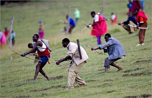 Massai warriors approach a group of Kalenjin warriors during a bow and arrow battle in the Kapune hill in the Olmelil valley located in the Transmara District on March 1, 2008 in Western Kenya. The Massai, the Kalenjin and the Kisii tribes have recently clashed over ongoing land disputes that erupted after botched local elections during the general elections held in Kenya in December of 2007. Over twenty warriors from the tribes have been killed in bow and arrow battles near the borders of these tribes in the last couple of months.