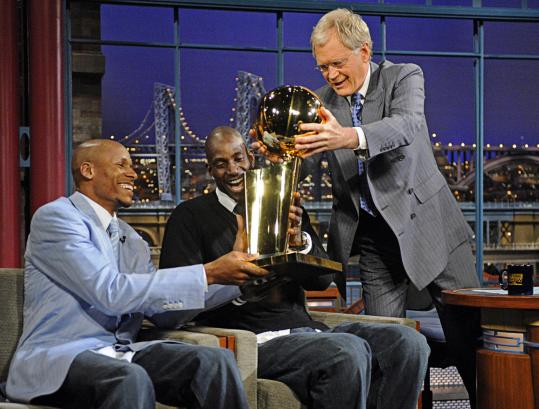 From left: Ray Allen, Kevin Garnett, and David Letterman admire the NBA championship trophy.