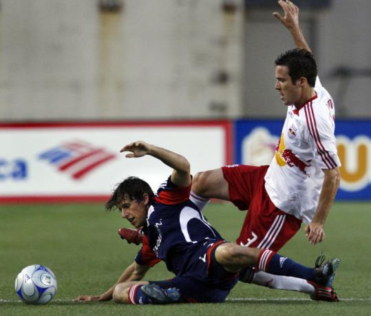 Wells Thompson gives himself up to beat the Red Bulls' Hunter Freeman to the ball during first-half action.