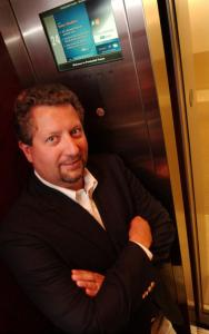 Hopkinton's Mike DiFranza rides a Prudential Tower elevator with his Captivate Network.