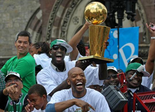 The Celtics benefited from huge bench contributions during the season, especially in the playoffs. Sam Cassell (front) received plenty of cheers yesterday as Kevin Garnett held the championship trophy aloft.